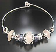 Three super rare, Depression Era pink sea glass gems were found upong a Pacific Ocean beach. They are threaded onto an 8 bangle and accent beads are sterling silver, glass and base metals. Beads wont slide. They will arrive in a cotton lined gift box and on a card that tells the short story of sea glass and the name of the ocean your pieces were beach combed from.