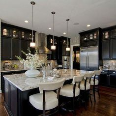 Kitchen with dark cabinets, and slightly lighter floors.