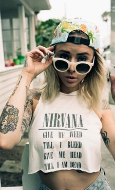 Well inked, with an asymmetrical haircut and a height under 5'7, Alysha Nett is and will be the perfect model for streetwear. She proves this again on her personal style blog called The Bleached Niche. In this secreted pictorial she wears a Nirvana shirts made by O-Mighty, white rounded glasses by Crap Eyewear, ripped grey blue jeans and a colorful fruity cap signed by Stixfigure. Check the hidden gallery down below !