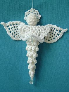 "This beautiful angel is quick to make up and will look great hanging on your tree, as a package adornment or gift for a friend. It is made using size 10 crochet cotton thread and measures approximately 5 1/2""W x 5 1/4""L, excluding bead. Bead embellishment is optional."