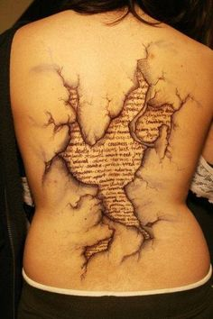 Cool Ancient map tattoo on girl back