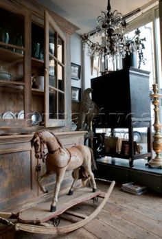 JST001_03: Antique shop interior with wooden rocking ho - Narratives Photo Agency