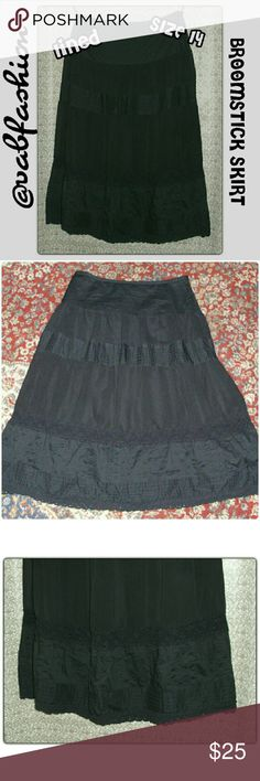"BLACK PEASANT SKIRT!! Beautiful black high waisted broomstick style/ peasant skirt. Made by Apostrophe! Shell is a mix of a silky pleated some what sheer material and lace. The skirts shell has multiple sections and is edged with a floral lace. Lining is black as well and is the full length of the skirt. Skirt has a 7.5"" side zipper and hook closure. Shell is 75% cotton and 25% polyester. Lining is 100% polyester. Length is 33"" waist is 34"" hips are 41"" Apostrophe Skirts"