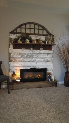 Ive been wanting one of those wall mounted electric fireplaces for a while now andwith Winter and the holidays right around the corner it seemed likethe perfect time to build my faux firep Pallet Fireplace, Faux Fireplace Mantels, Wall Mounted Fireplace, Farmhouse Fireplace, Modern Fireplace, Fireplace Design, Fireplace Ideas, Fireplace Decorations, Cabin Fireplace
