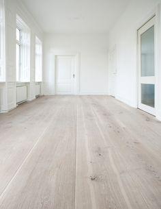 Amazing space  white walls  whitewashed wood floors.   WHITE