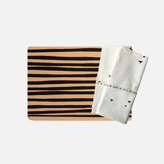 Stripe Cork Placemat Set of These placemats feature a black striped print, making a striking contrast to the cork it's been printed on. Bird Napkin Set of These linen napkins feature a black bird print on a white background.