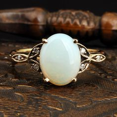 Vintage Opal ring with gold band and diamonds