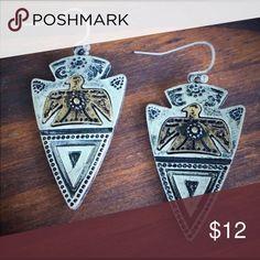 Silver Arrowhead Tribal Earrings Brand new silver Arrowhead earrings with gold thunderbird accents. Boho, gypsy, tribal, Aztec, Navajo, southern, southwest, western, rodeo, cowgirl style. Jewelry Earrings
