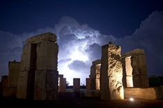 thunderstorm seen through a replica of Stonehenge at the University of Texas in Odessa, Texas