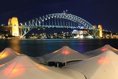 Sydney Harbour Bridge at night from Opera House concourse by Eat.Drink.See.Do., via Flickr