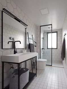 Make your bathroom look bigger, improve the decor and maximize its space with these 15 narrow bathroom ideas! Take a look at these great tips and tricks that will make your bathroom stylish and functional. Long Narrow Bathroom, Narrow Bathroom Designs, Bathroom Interior Design, Long Bathroom Design, Narrow Bathroom, Bathroom Makeover, Shower Room, Narrow Bathroom Vanities, Bathroom Design Small
