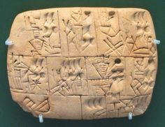 One of the earliest examples of writing known. And it is used here to record the allocation of beer. Late Prehistoric (3100- 3000 BCE), and probably from southern Iraq. Beer was issued as rations for workers, and was the most popular drink in Mesopotamia. The symbol for beer appears 3 times on this particular tablet (note the depicted upright jars with pointed bases). Courtesy of & currently located at The British Museum, London: ME 140855. Photo taken by BabelStone