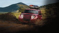 Trail Rated® Liberty Sport 4x4 shown in Deep Cherry Red Crystal Pearl with Authentic Jeep® Accessories by Mopar. Properly secure all cargo. Facebook: https://www.facebook.com/JeepCanada Twitter: https://twitter.com/jeepcanada