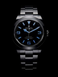 The new Rolex Explorer in 904L steel with a fully luminescent Chromalight display emitting a blue glow, an Oyster bracelet and a smooth bezel.