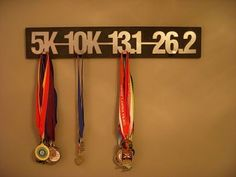 Running medal display broken into distances.|   do them on separate boards to add additional distances in between