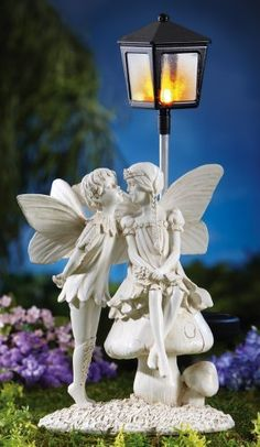Moonlight Fairies Solar Lighted Garden Statue from Collections Etc. Fairy Statues, Garden Statues, Garden Sculptures, Solar Fairy House, Flower Garden Design, Flowers Garden, Clay Flowers, Sacred Garden, Garden Figurines