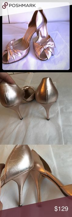 Valentino metallic rose gold sandals Worn several times, peep toe front. Have some light scuffing but no discoloration and not noticeable when on, as the shoes have a grainy/gentle pebble leather. Size 35 but will fit a smaller 36. Valentino Shoes
