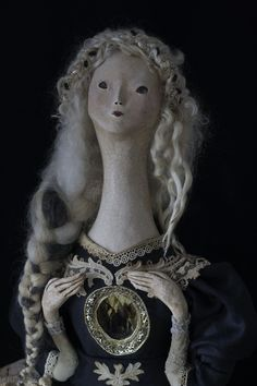 ooak art doll 'Philomyna' by Pantovola, of the Dusk Dwellers series. She holds a butterfly in her chest