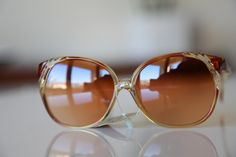 Golden Brown Tortoise frame, and with Golden Brown lenses from Polaroid's Vintage Sunglasses Collection    Product ID POLAROID LOOKERS 8417 made in France