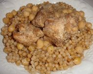my mom used 2make this 4me n I <3d it Arabian dish ..Moftoul w/chickpeas and chicken <3