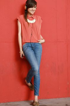 red loose top (with rolled up sleeves), jeans, leopard print shoes