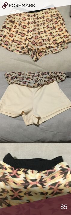 Flirty skirt with built in shorts Adorable  skirt with a unique orange yellow and brown pattern. Has Daisy Duke shorts underneath with a sheer overlay. Perfect condition worn once Shorts Skorts