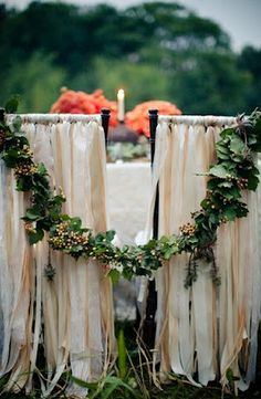 Vintage style bride and groom chair. Tied together with garland..I will definitely do this!