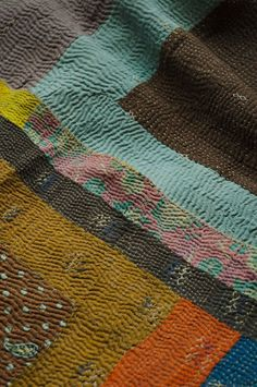 Batixa...looks like Kantha quilts sewn together in strip quilt form