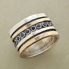 """SAPPHIRE RIVER RING--In this blue sapphire river ring, sterling silver, 14kt gold and a stream of blue sapphires flow together like dancing currents of water. Hand cast and hand finished. Exclusive. Whole sizes 5 to 9. 9/16""""W."""