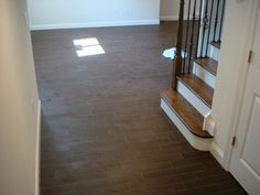Wood tile floor set on thirds to mimmic a wood floor layout | New Jersey Custom Tile