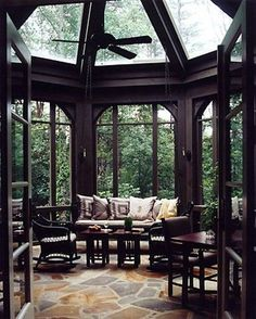 "A thunderstorm room...someday I will have a room like this. How amazing would that be to sin under glass and listen to the pounding of the rain. And I love the dark framing of the room. Makes the outside like living art on the ""walls""."