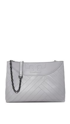 The slouchy Tory Burch Alexa tote has a soft, quilted exterior. The  concrete gray color is perfect for work or weekends. 0ef0951a4a