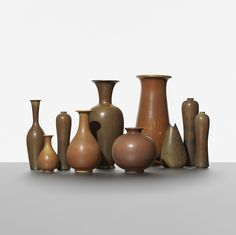 Gunnar Nylund collection of ten vases. Rorstrand Sweden, c. 1950, glazed stoneware, 6.5 dia x 15.75 h inches. Incised signature and studio mark to underside of each example: [R Sweden GN].