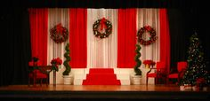 Simple use of colors and curtains to create elegance. The openness of the stage adds to the sense of large space. Christmas Stage Decorations, Christmas Stage Design, Church Stage Design, Christmas Settings, Holiday Decor, Annie Musical, Annie Costume, Christmas Concert, Christmas Pageant