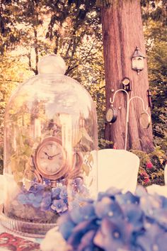 Time-themed head table centerpiece and background from our Peter Pan themed backyard wedding stylized photoshoot