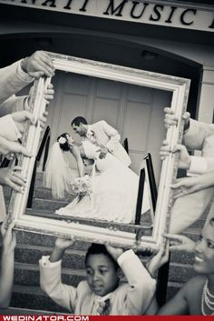 Cute idea. I like that the guests are holding the frame.