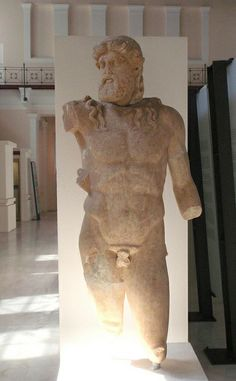 Marble statue of Zeus. From Olympia, the Nymphaeum. 2nd c. CE Olympia, Archaeological Museum, Λ 109  On display in the Museum of the History of the Olympic Games in Antiquity. Ancient Olympia, Greece