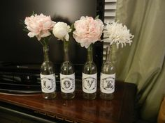 Great idea for guest book table! Vineyard touch with the wine bottles!