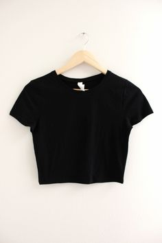 Solid black crop top with short sleeves and no graphic. Available in two sizes XS/S and M/L.