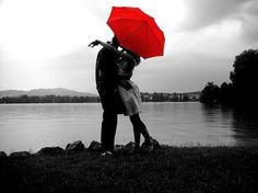 Ok, so maybe its not raining in the picture, but I love the contrast of the red umbrella with the black and white photography