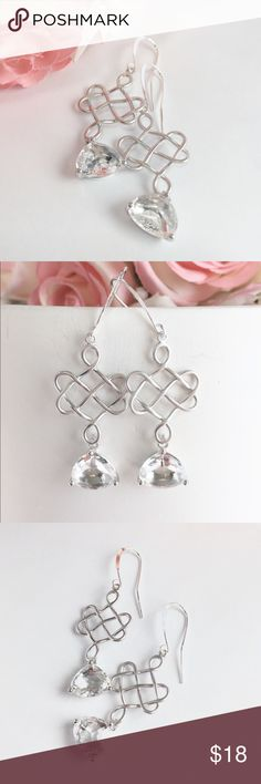 Crystal silver Celtic knot earrings Elegant silver knot and crystal glass bead earrings. The monochromatic color will go with everything in your closet! Lovely enough for a special occasion and would dress any simple outfit. The ear wires are sterling silver and the pendant is silver plated. These earrings are new and have never been worn. Jewelry Earrings