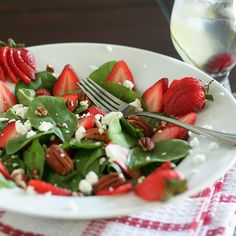 Spinach, pecans (candied walnuts would be so good!), goat cheese, strawberries and a honey balsamic dressing..yum.