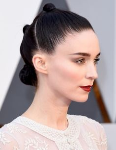 Rooney Mara. Her makeup is immaculate! Soft smokey eyes and deep ruby-red lips