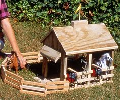 Big Stable is my easy-to-build stable plan for toy horses (the common and popular 1/12th scale horses work best!). http://www.playfulplans.com/product/big-stable