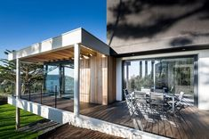 Image 9 of 38 from gallery of House in Crozon / Agence d'architecture Pierre-Yves Le Goaziou. Photograph by Pascal Léopold Commercial Architecture, Residential Architecture, Beautiful Architecture, Contemporary Architecture, Eco Construction, Terrasse Design, Red Cedar Wood, Wooden Terrace, Design Salon