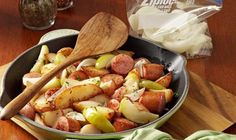 Sausage Skillet Dinner Recipe Main Dishes with smoked sausage, butter, potato wedges, onions, apples, cider vinegar, sugar, caraway seeds, fresh parsley