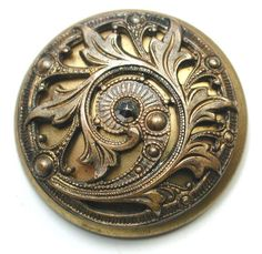 large two-piece domed brass button, with cut steel. ca. late 19th century