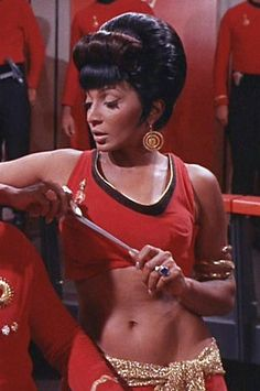 Before Carrie Fisher ever put on the bronze bikini outfit, there was Nichelle Nichols as Lt. Uhura making boys into men.