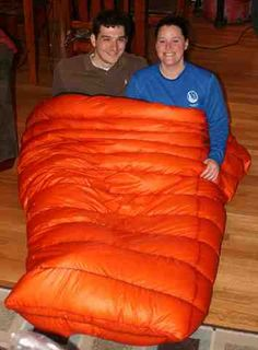 "Two Person Quilt Adventures in crafting a 2 person down quilt. For the last two years Sherpa and I have been using a winter weight down sleeping bag opened in a quilt fashion as our nightly backpacking insulation. This allowed us to cut the weight of our kit as we were only carrying one sleeping bag for the two of us. It works reasonably well for three seasons and allowed us to ""try"" using a quilt to see if it worked for us. You might ask, well then why did you continue using it for..."