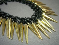 Urban Chic Black and Gold Spike Statement Bracelet by DesignTheory, $32.00